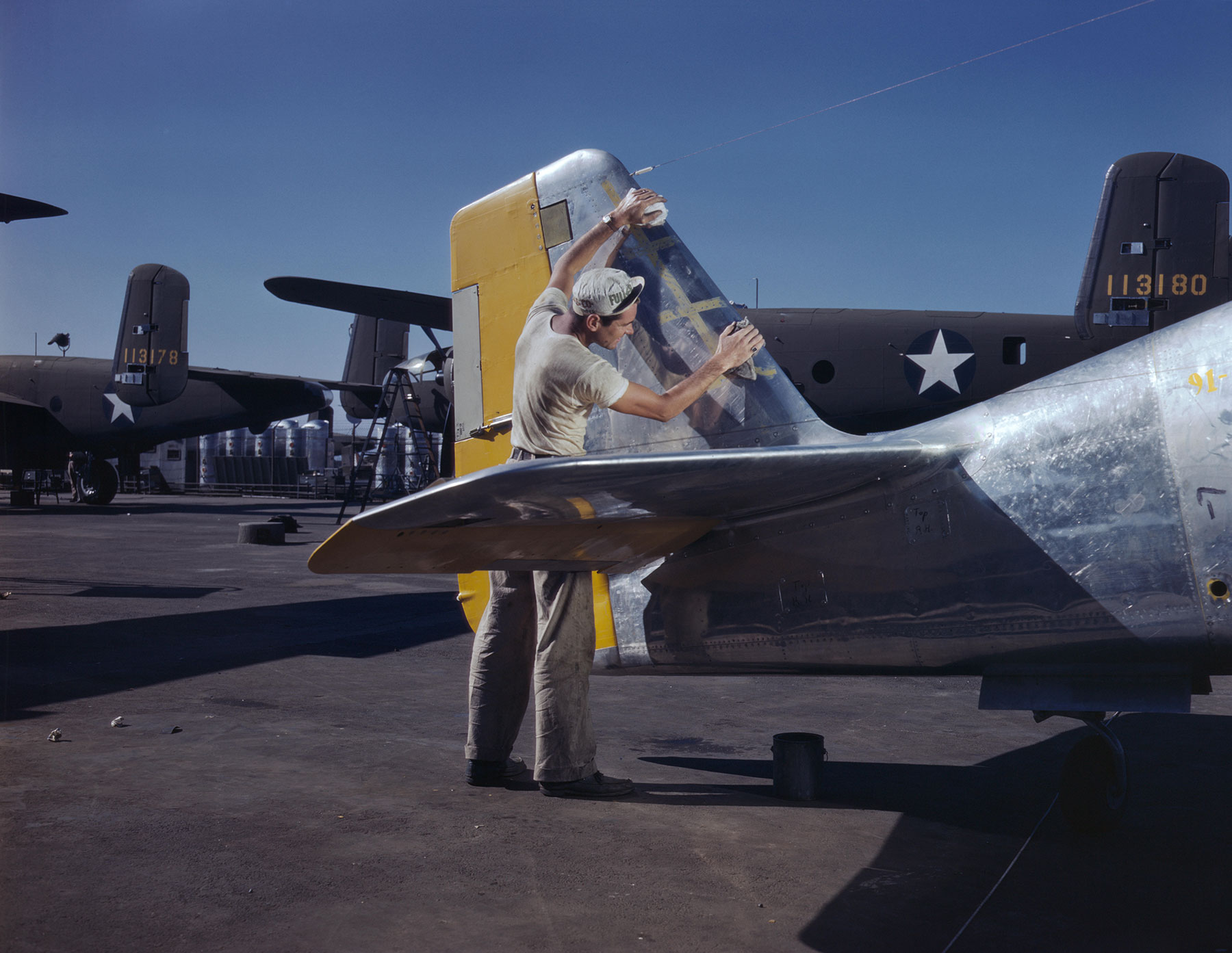 WWII Worker Painting P-51 Mustang